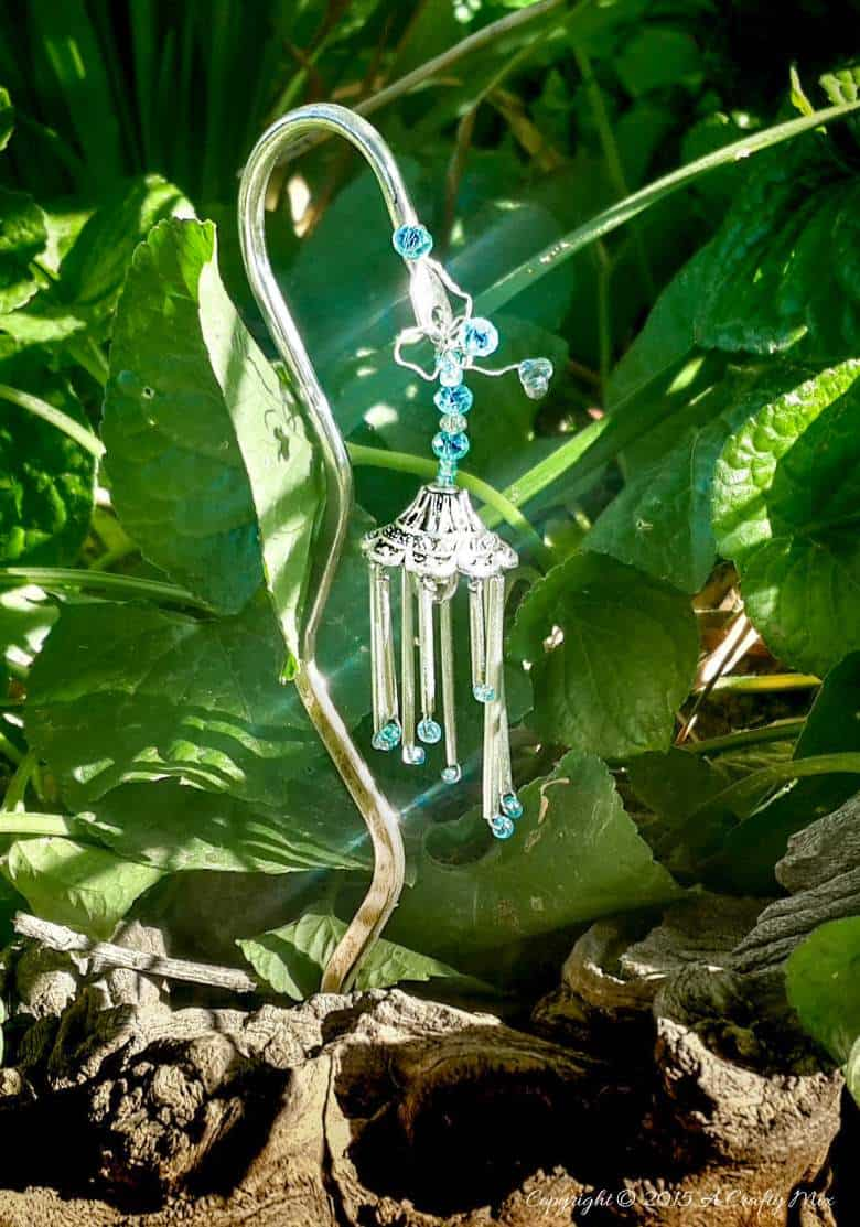 A Quick and Easy tutorial that will show you how to make Fairy Wind Chimes. #fairywindchimes #fairygarden #acraftymix #fairytutorial