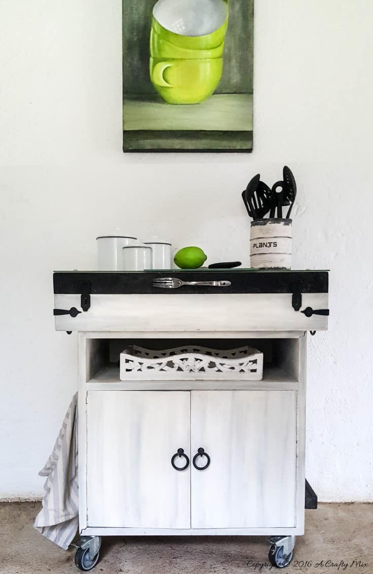 So many thrift store finds can be used to make a kitchen island. Here we used a fishing tackle box and office storage to create this one. #KitchenIslandDIY #Repurposed #ACraftyMix #ThriftStoreFinds