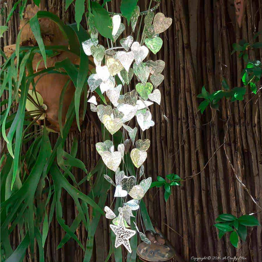 Re-urpose an old lamp shade and make your own Chain of Hearts mobile using this easy tutorial #gardenideas #gardenart