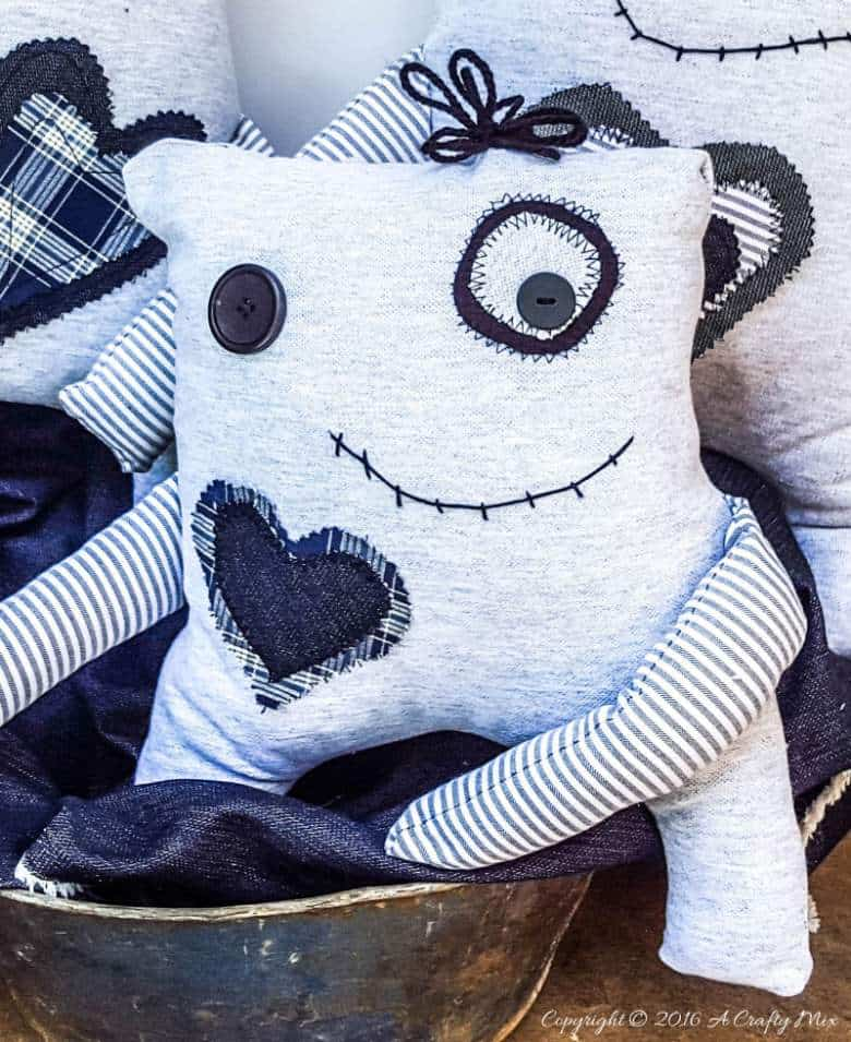 Make your own little Momster. Includes a free easy-to-sew pattern and lots of ideas to customize their little faces. #sewing #momster #ACraftyMix #freepattern