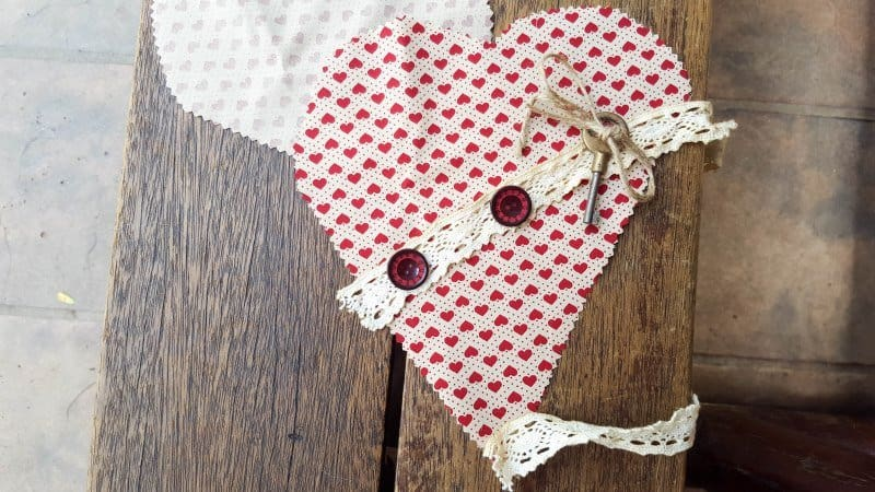 Place your fabric scraps on the heart, keeping it simple and innocent