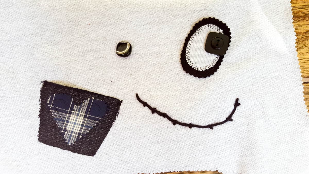 Play around with buttons and fabric scraps to make your Momster unique