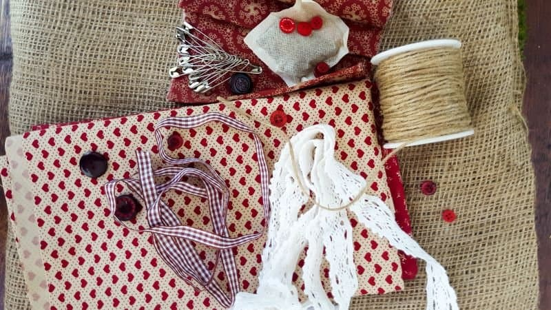 Fabric scraps, lace, burlap, buttons, and safety pins