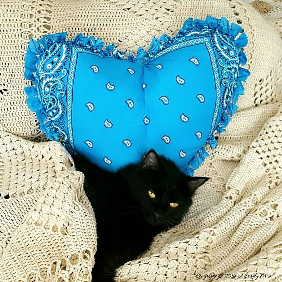 Make this easy no sew bandana heart pillow in less than 30 minutes. #NoSew #HeartPillow #ACraftyMix