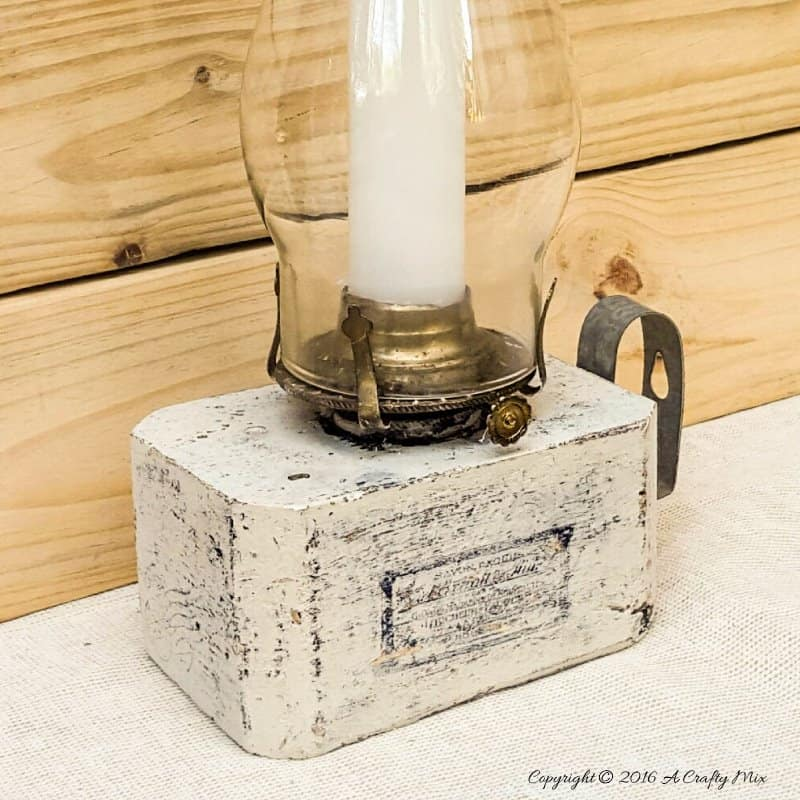 Turn block pallets into these rustic farmhouse lanterns. Quick and easy recycled idea. #pallets #repurposedDecor #ACraftyMix #FarmhouseDecor