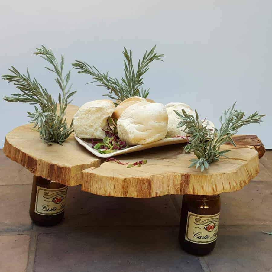 Naturally beautiful wood and bottles centerpiece