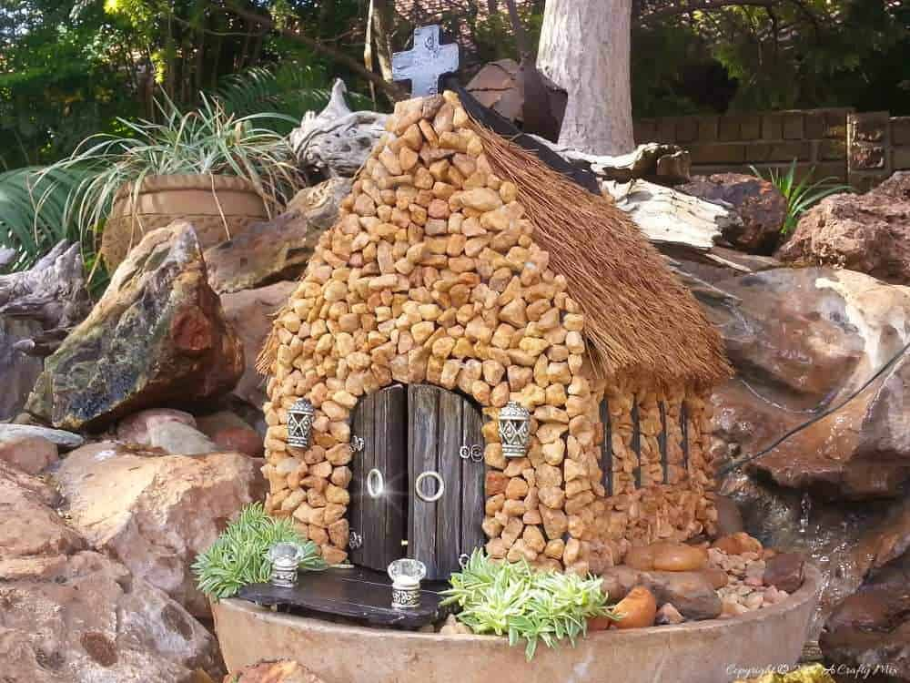 A beautiful addition to a fairy garden. This miniature church was made from a wooden tissue box and coconut hair