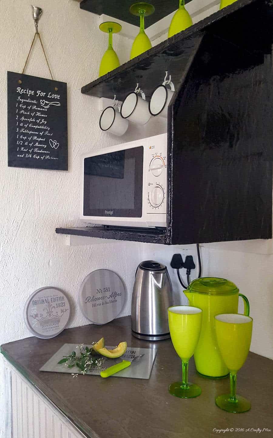Lime green plastic jug and wine glasses