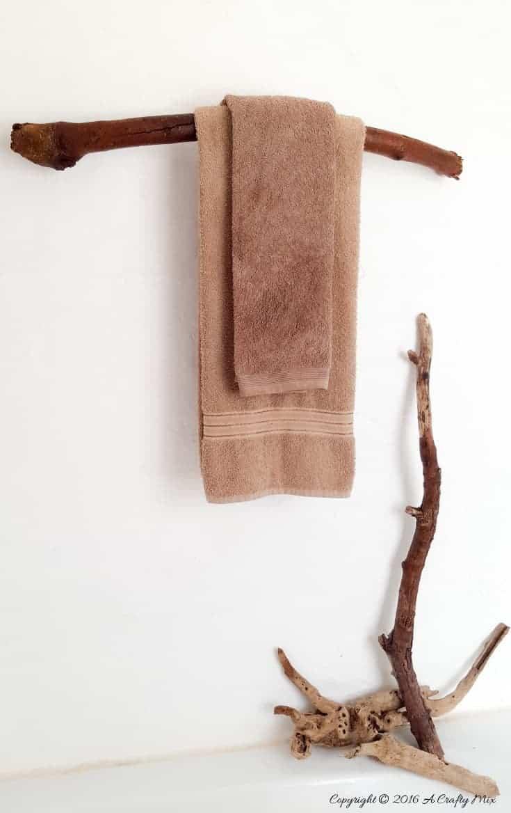 How to make a unique towel rack from a branch. Quick and easy DIY tutorial #DIYHomeDecor #Branchtowelrack #branchrepurpose #DIYTutorial #DIYBathroomdecor #Acraftymix