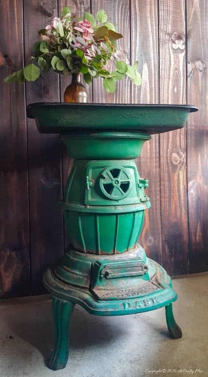 Repurpose a cast iron stove and an old roasting pan to make an interesting OOAK side table. Come see how we did it on the blog #Repurpose #Castironstove #ACraftyMix #recycledhomedecor #homedecor