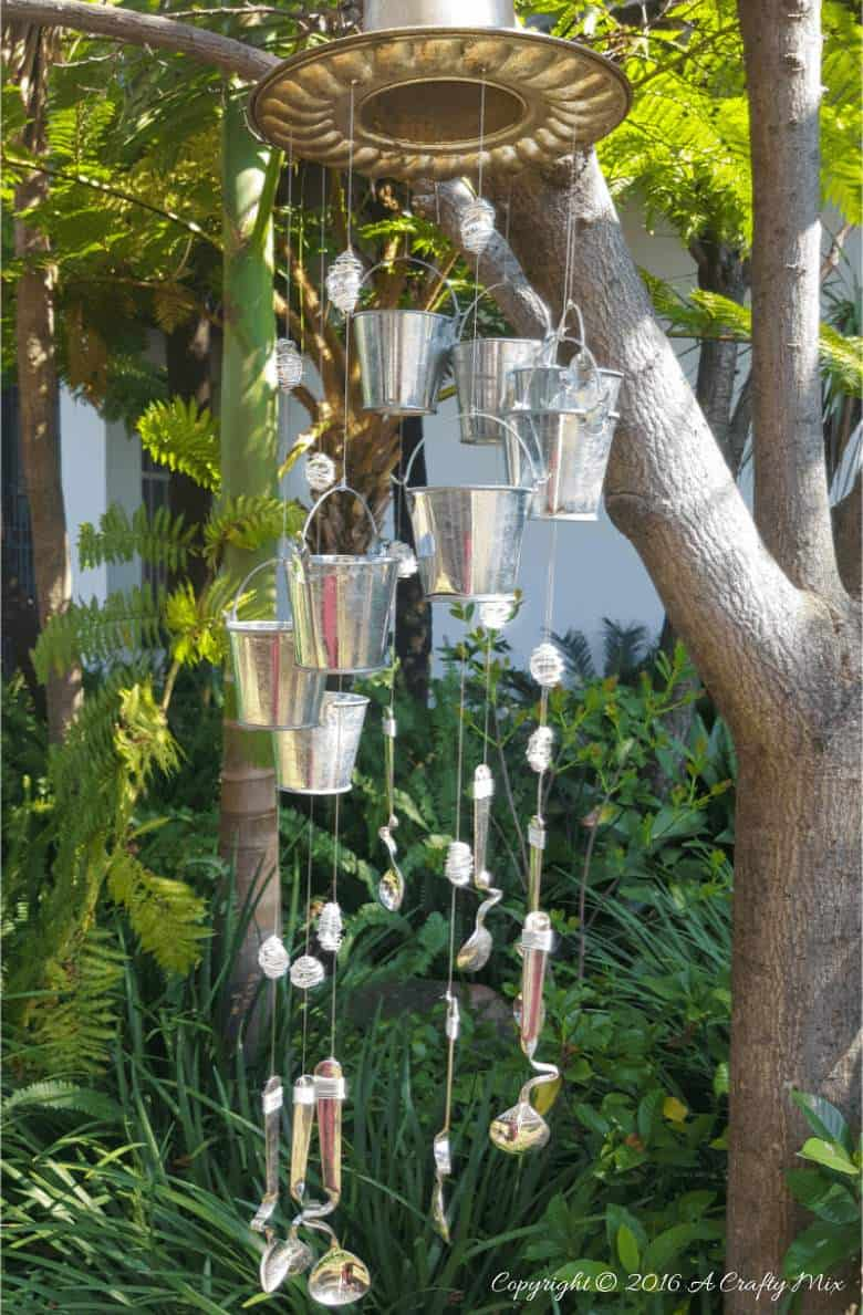 If you enjoy repurposing things, you'll love this easy tutorial that will show you how to turn a jelly mold into a one-of-a-kind wind chime. #windchimeDIY @acraftymix #repuposedwindchime