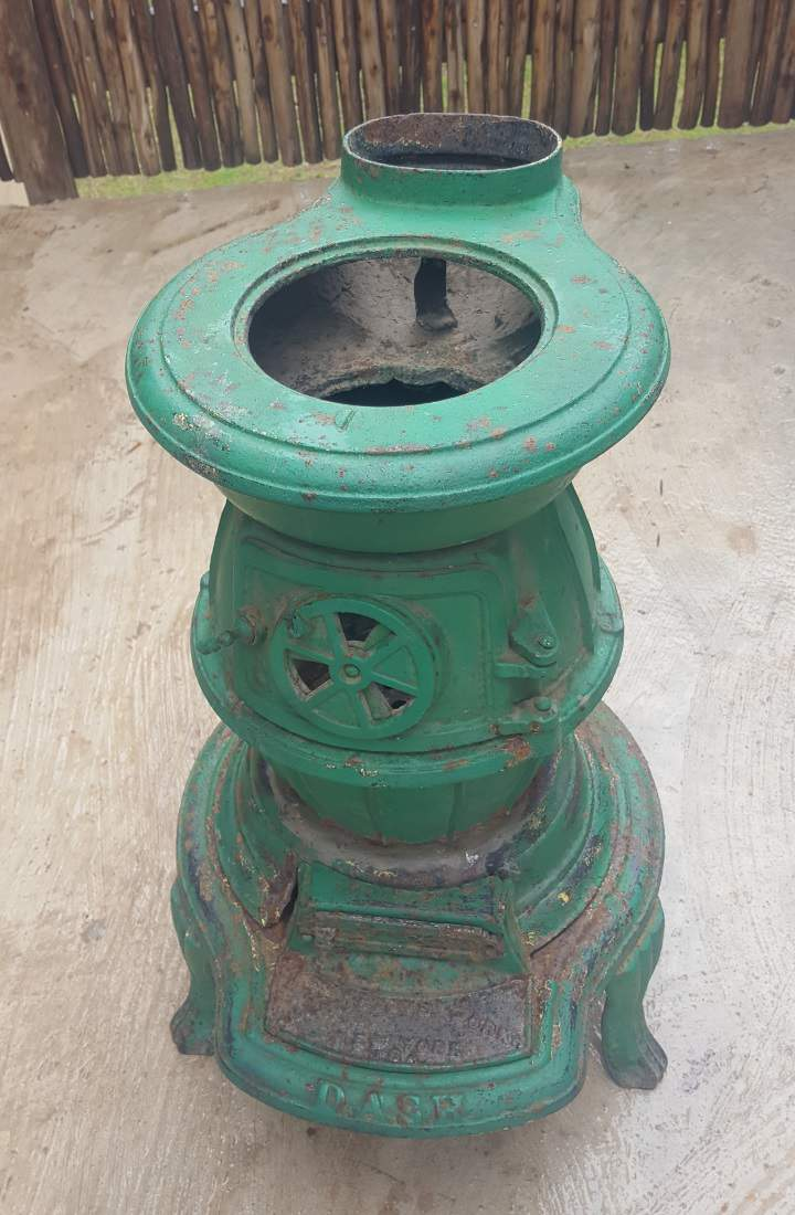 Recycle a cast iron stove to make a OOAK side table that will leave a lasting impression on your guests
