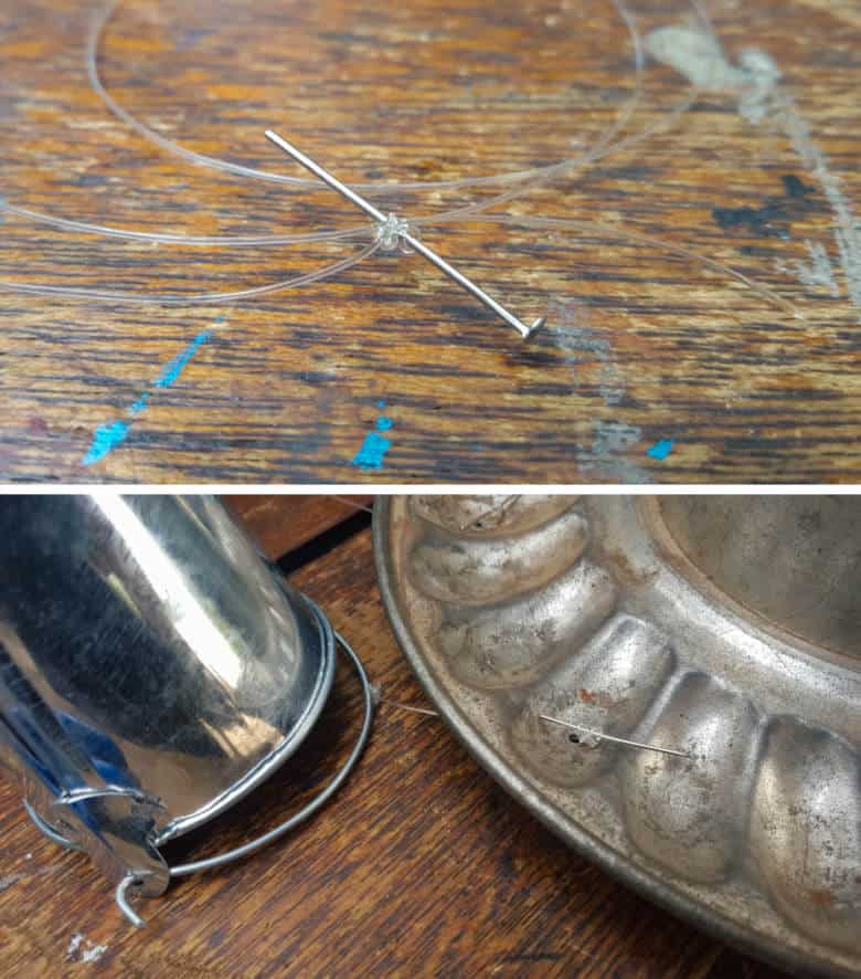Wrap fishing line around a pin and push the pin up through the holes in the jelly mold