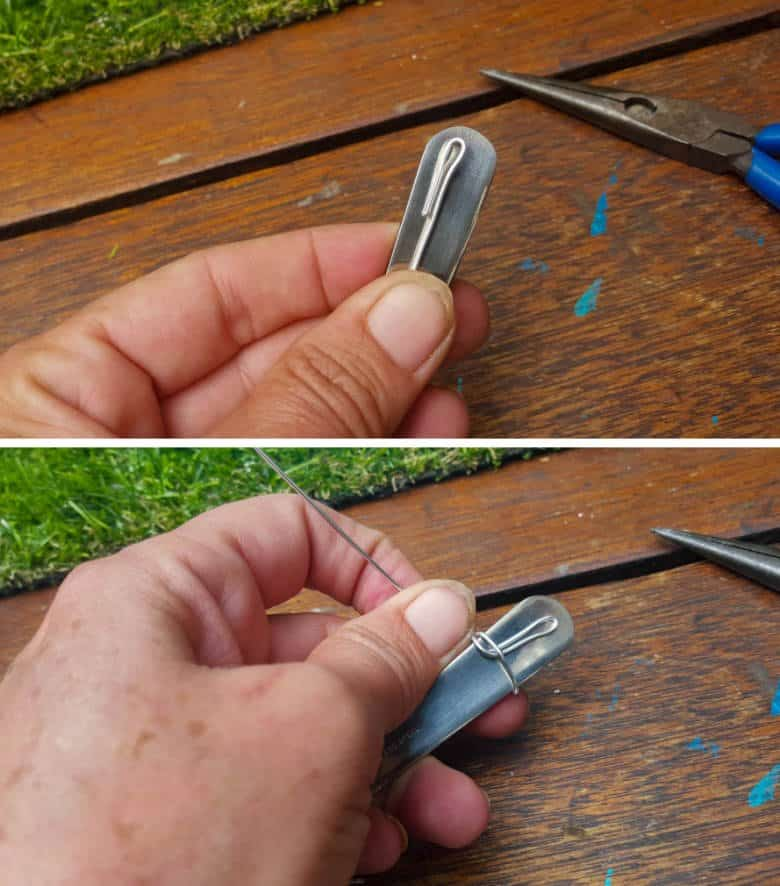 Place the small loop on the back of the spoon and start wrapping the wire around the spoon to secure