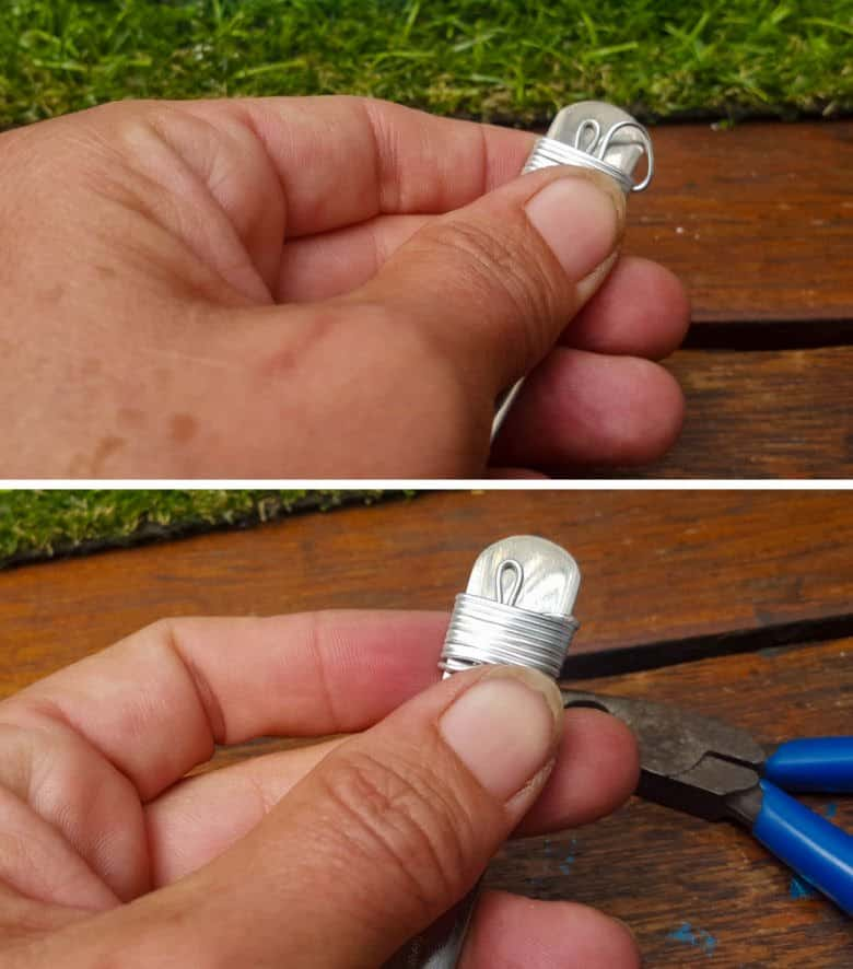 Continue wrapping the wire around the spoon a few times before cutting the wire and tucking the end into the wrapped wire
