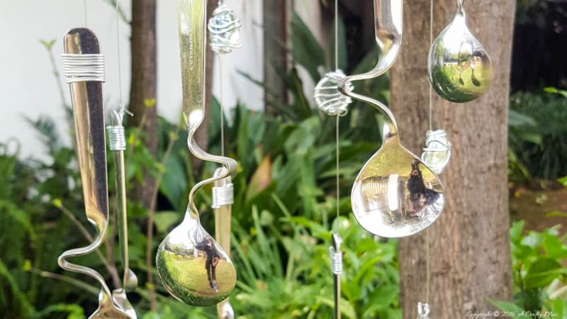Combine curved spoons and wire wrapped glass beads to make this repurposed wind chime