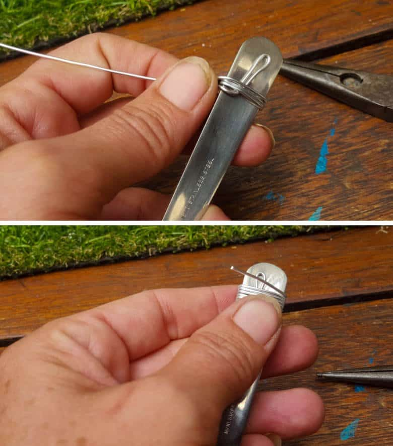 Continue wrapping the wire around the spoon a few times before cutting the wire