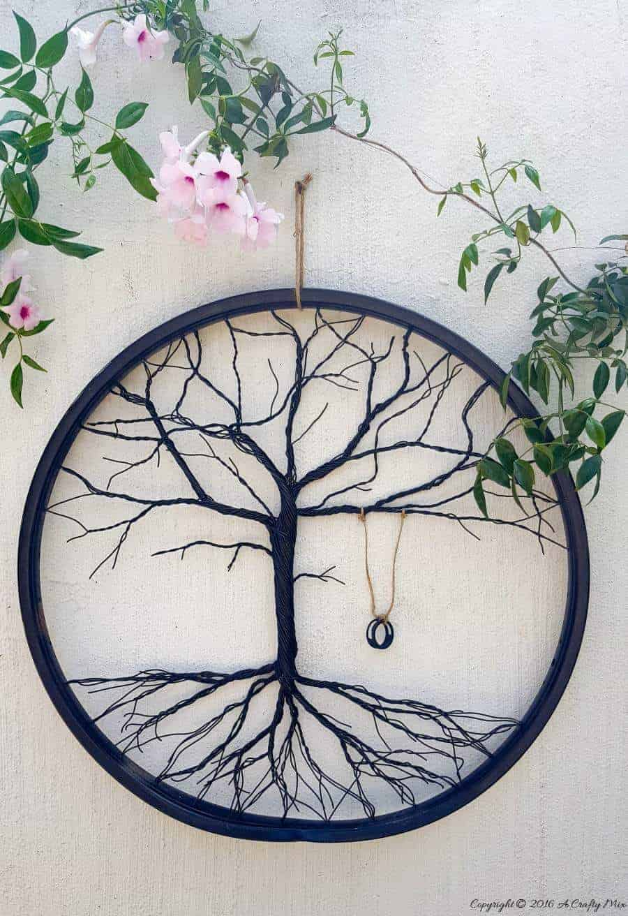 Re-purpose a broken bicycle wheel and make a tree of life. Full tutorial on the blog #DIYHomeDecor #Repurpose #repurposed #bicycle #treeoflife #acraftymix #DIYtutorial #bicycleupcycle #brokenbicycle