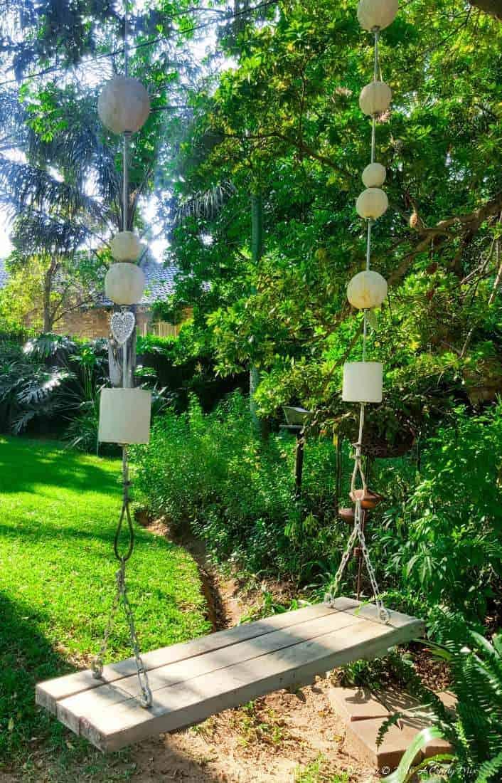 How we built a dreamy garden swing for under $15 #gardenswingDIY #Palletswing #romanticswing #acraftymix #fairytaleswing #gardenswingbuild
