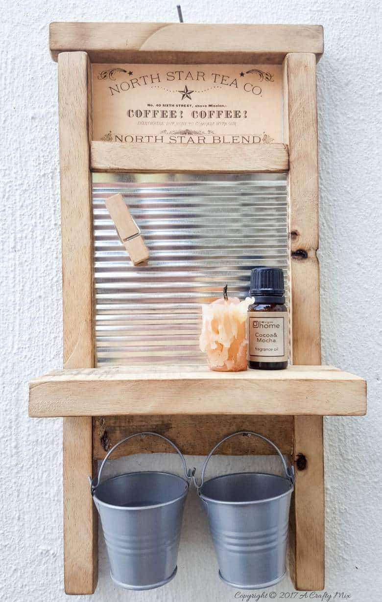 Isn't this antique washboard just too adorable. It's a great way to upcycle a tin can and add something special to your laundry room. #tincanupcycle #laundryroomdecor #acraftymix #DIYDecor #laundrystorage #tincanrepurpose #DIYWashboard