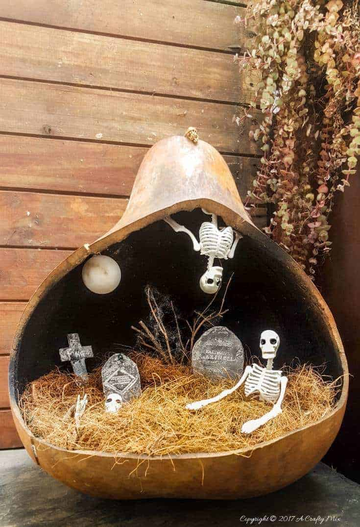 A quick and easy fairy graveyard that will instantly get you into the spirit of Halloween. And best of all, the moon shines at night #halloween #halloweendecorations