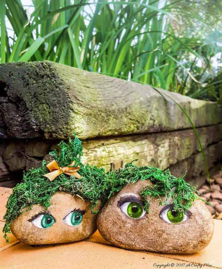 Make the cutest little mossy couple for the garden and easy tips on how to paint eyes on rocks