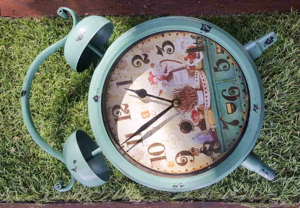 The cutest little clock fairy garden. Includes full plans for making the porch swing and the miniature topiary trees