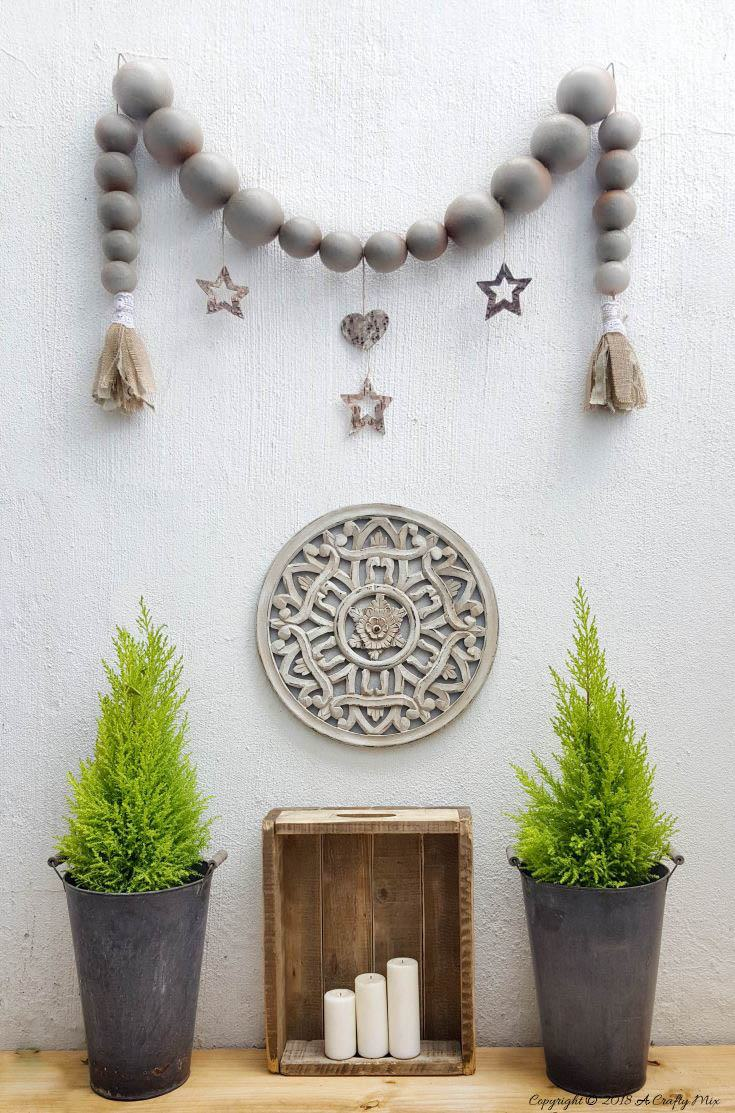 An easy tutorial for creating an extra large bead garland with tassels for less than $10 #DIYHomeDecor #BeadGarland #DIYTutorial #GalleryWall