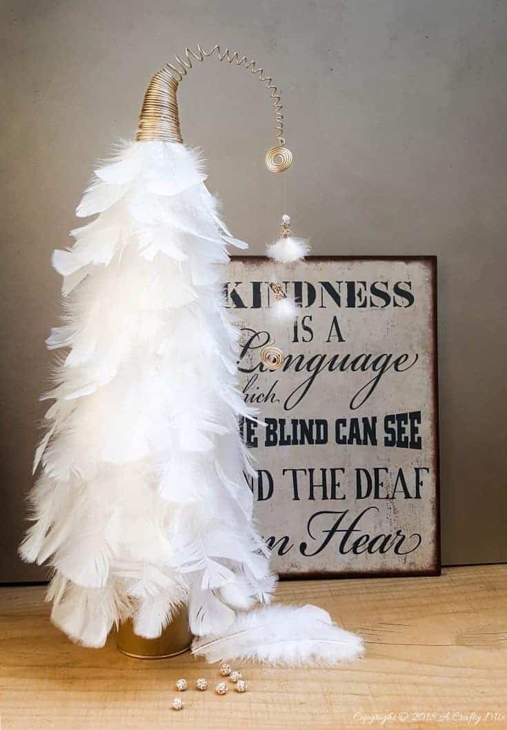 How to make a classy Whoville inspired Christmas tree. Fun and easy to make #WhoVille #ChristmassTree #ChristmasTutorial #ChristmasCrafts #FeatherTree