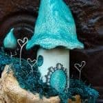 A little fairy home made from a cardboard tube and cotton wool. Add a few whoville inspired Truffula trees to make an unusual fairy scape #FairyGarden #FairyScape #FairyTutorial #ACraftyMix #CraftTutorial #FairyCraft