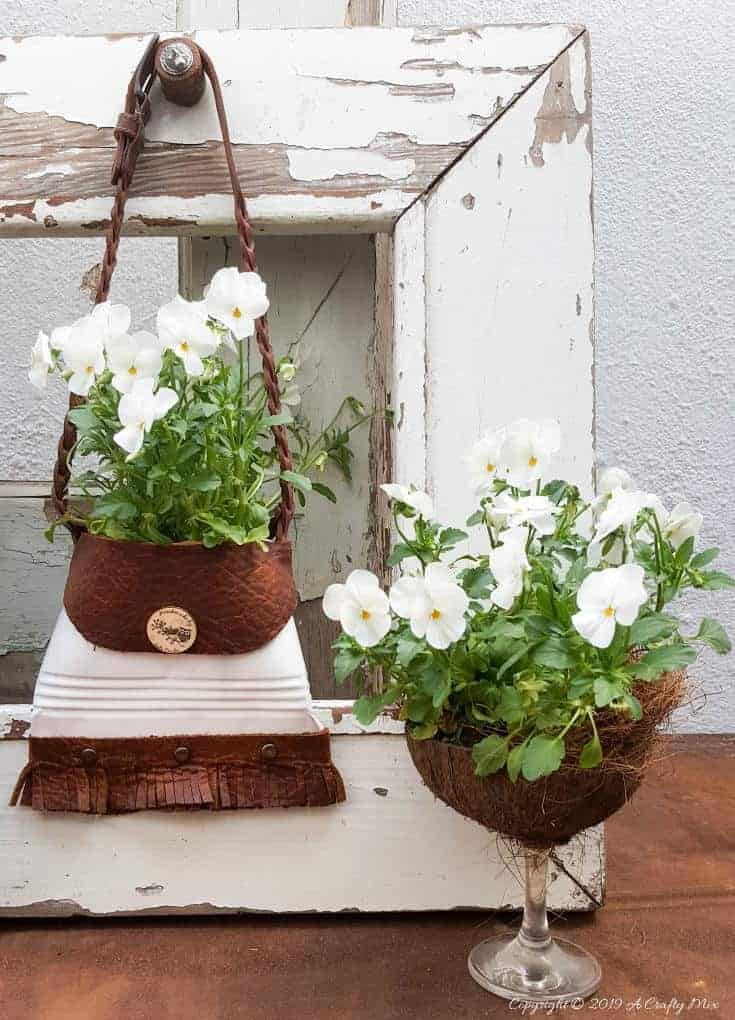 A beautiful recycled tin can handbag and coconut wine glass planters. Tutorials for both can be found on A Crafty Mix #tincan #recycle #repurpose #tincanrecycle #tincanplanter #acraftymix #creativetincanprojects #uniquetincanDIY