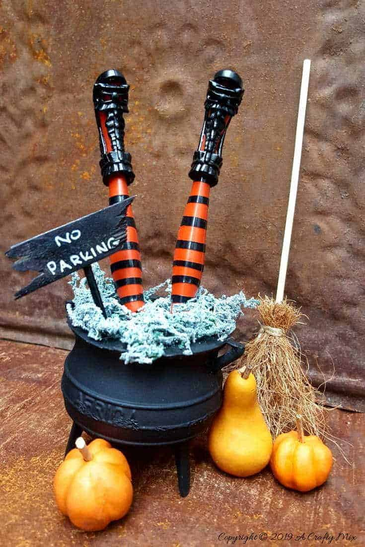How to make wickedly wonderful miniature witch legs in a cauldron. Inspired by Grandin Road #Halloweendecor #dollmakeover #spidergirl #acraftymix #halloweentutorial #halloweenDIY #witchlegs #grandinroad #miniaturehalloween