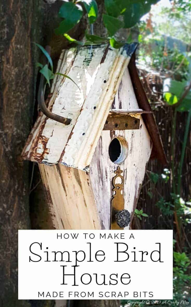 Want to add some rusty curb appeal or improve your backyard? This unique recycled birdhouse is made entirely from scrap bits and has so much character. It's inexpensive and easy to make too The tutorial includes all the instructions to make your own. #rusticbirdhouse #DIYbirdhouse #paintedbirdhouse #acraftymix #birdhouseideas #uniquebirdhouse