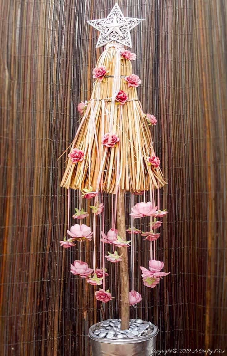 How to repurpose a broom into a Christmas tree. Fun Festive Decor with a twist #broomrepurpose #broomchristmastree #acraftymix #broomdecor #christmastree #DIYChristmasTree