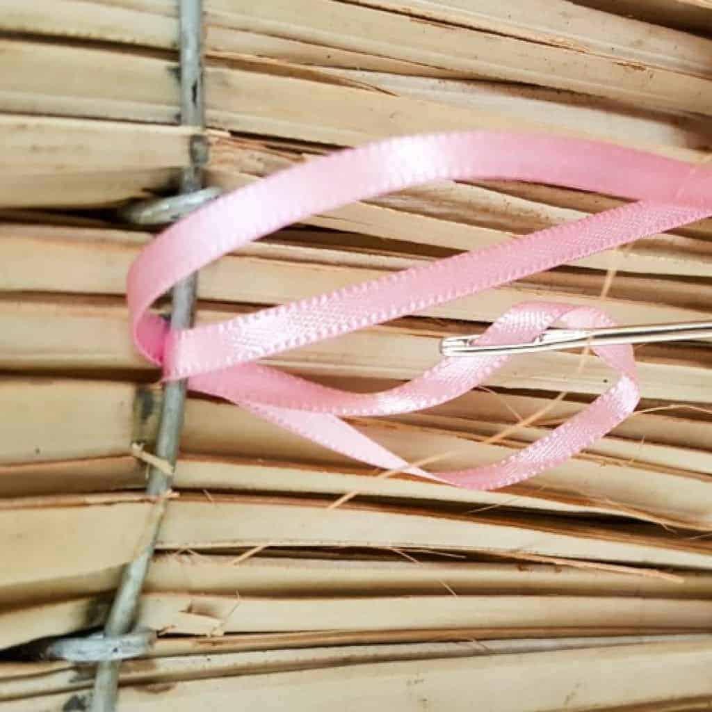 Sew the ribbon into the broom Christmas tree #broomrepurpose #broomchristmastree #acraftymix #broomdecor #christmastree #DIYChristmasTree