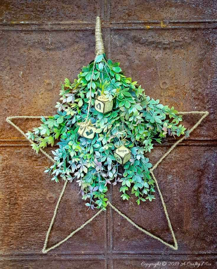 If you struggle to find a star wire wreath frame you can make your own using this easy to follow tutorial. #WireWreathFrameDIY #EasyStarWreath #aCraftyMix #HowtoWireWreath #StarWireWreath