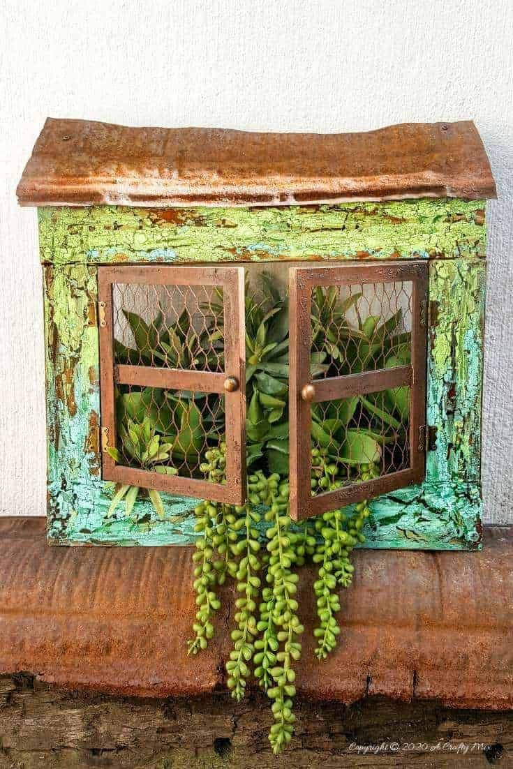 """Full tutorial how to make this gorgeous """"Cracked Up"""" Unicorn SPiT planter with plastic picture frame windows. Includes how to get a rust effect with US #UnicornSpitTechniques #Windowplanter #UnicornSpitRustEffect #FauxRustEffect #ACraftyMix #PictureFrameRepupose #UnicornSpitIdeas #PictureFrameCrafts #SpillingPlanter"""