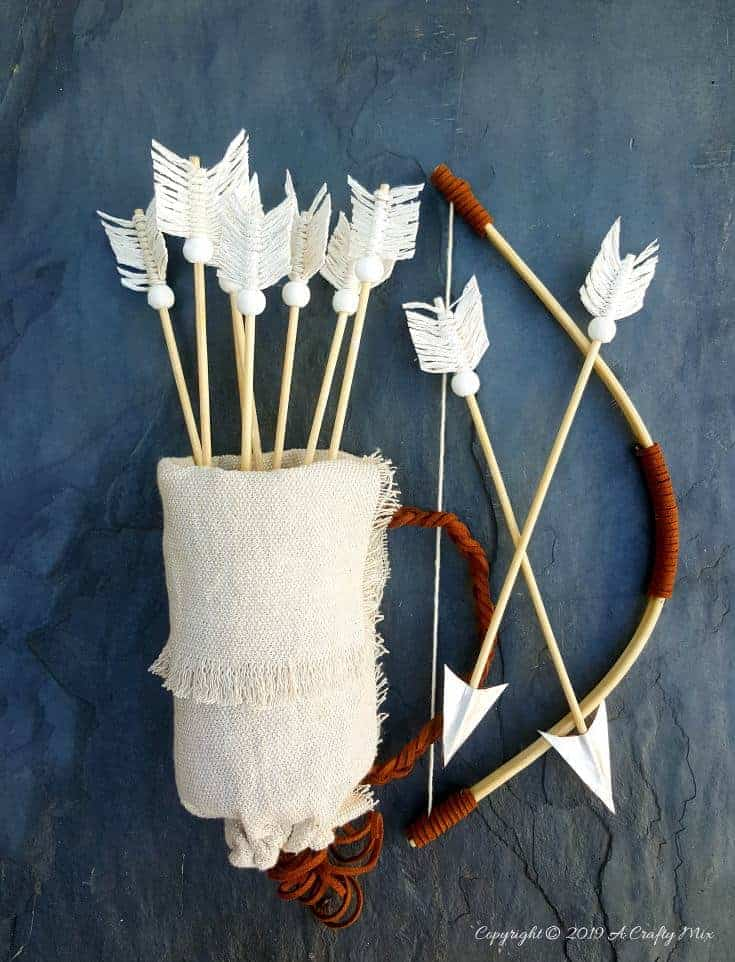 Make this no-sew quiver full of macramé arrows for Valentine's Day using empty soda cans. It's a fun gift idea and you can use it all year round in your home décor too. It only take an hour to make and you don't need any fancy tools or equipment either. #VintageValentine #TinCanRecycle #ValentineGiftIdea #QuiverArrows #AcraftyMix #HomeDecor #MacrameArrow