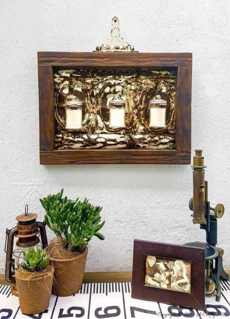 With Spring around the corner, it's time to start getting those outdoor spaces ready. Find out how we transformed a tin ceiling tile into this gorgeous candle holder and how you can change it into a planter with one small twist. #farmhousedecor #rusticdecor #acraftymix #farmstyledecor #springproject #diyhomedecor #ceilingtilerepurpose