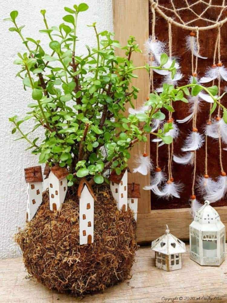 Take your moss ball string garden to the next level with this cute kokedama fairy village. Easy to make and customize. #EcoFriendly #Kokedama #FairyVillage #ACraftyMix #EasyGardenCraft #MossBalls #SpekBoom #kokedamaIdeas #StringGarden #IndoorPlants