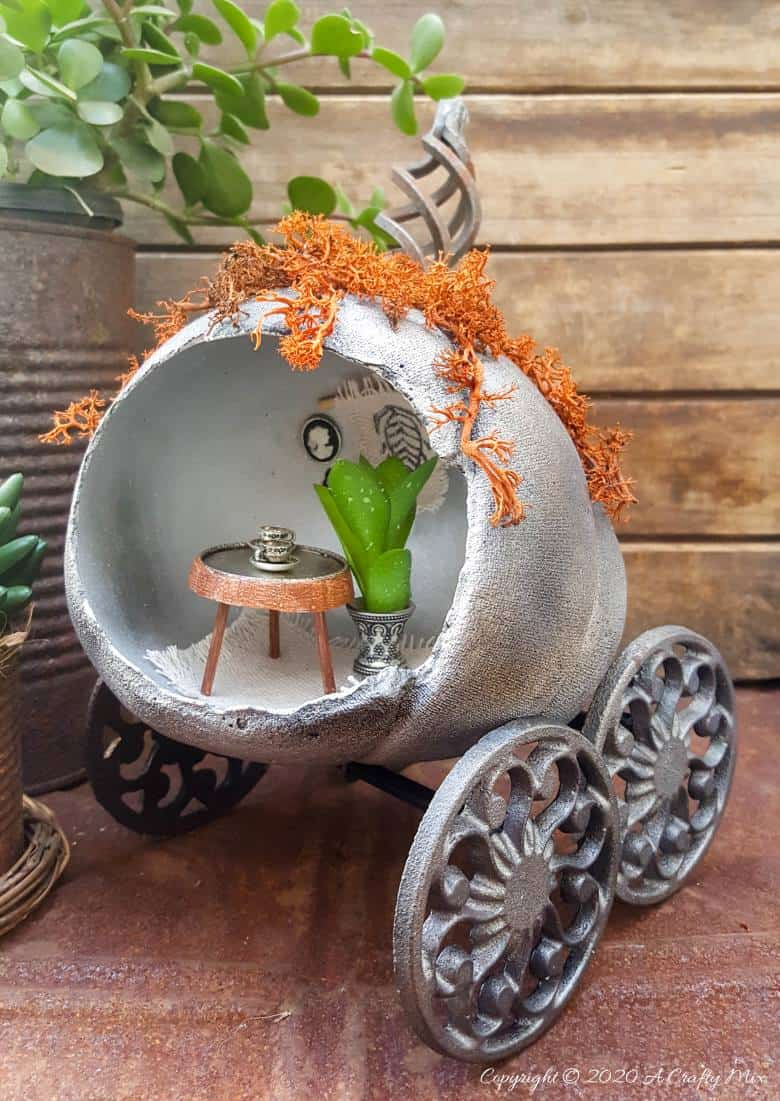 Ever wondered what happened to Cinderella's pumpkin coach after she and the Prince got married and lived happily ever after? Those little mice turned it into their secret hideaway and they shared the tutorial on how they did it with us. #FalldecorDIY #Pumpkincoach #ACraftyMix #PumpkinDecor #PumpkinCrafts