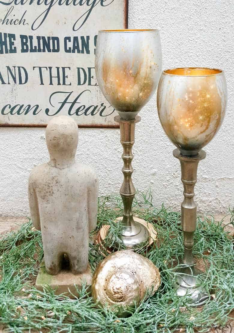 Don't throw those broken wine glasses away until you've seen how you can repurpose them to make these gorgeous chalice or goblet lights. The step-by-step tutorial includes a video that will show you how to cut the wine glass and how to get that mercury glass effect in two easy steps. #Wineglassrepurpose #BrokenGlass #ACraftyMix #DIYGoblet #Chalice #MercuryGlass