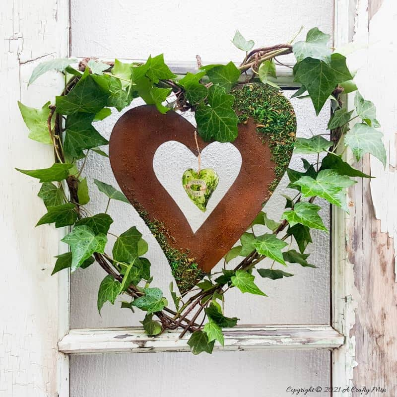 Celebrate the arrival of the most beautiful season of all and make this gorgeous Spring heart wreath. All that luscious greenery promises that the cold, miserable days of winter are almost over and that Spring is on her way, bursting with life and new growth. #SpringWreath #HeartWreath # ACraftyMix #DIYWreath #FreshIvy