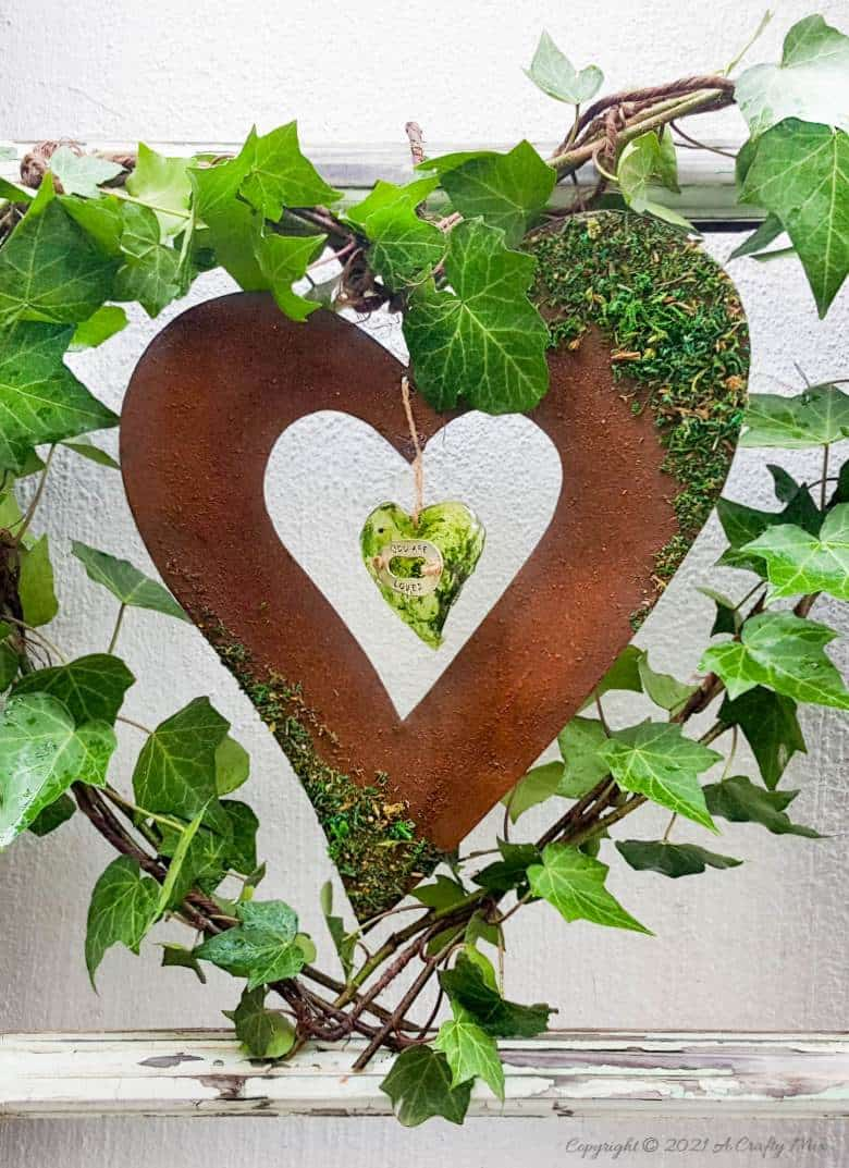 Celebrate the arrival of the most beautiful season of all and make this gorgeous Spring heart wreath. All that luscious greenery promises that the cold, miserable days of winter are almost over and that Spring is on her way, bursting with life and new growth. #SpringWreath #HeartWreath #ACraftyMix #DIYWreath #FreshIvy