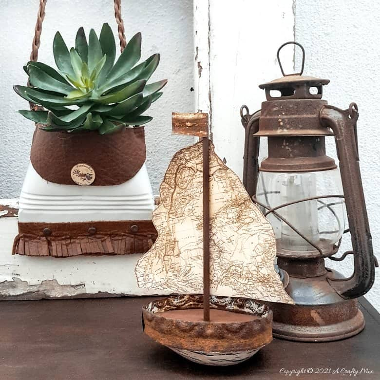 Looking to add some rustic charm to your coastal decor? This avocado sailboat is quick and easy to make and it's budget-friendly too. Customise the little boat and add a map sail of your favorite place or country. #avocadoupcycle #ACraftyMix #coastal decor #concretedecor