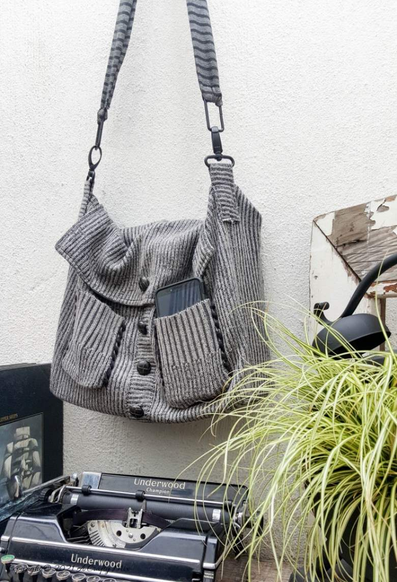 Don't throw that old sweater away until you've seen how easy it is to turn a sweater into a handbag. The tutorial includes a short video that will show you where to cut the sweater and includes step-by-step instructions to make your own. #SweaterHandbag #EasySew #ACraftyMix #HandbagPattern #SweaterRepurpose