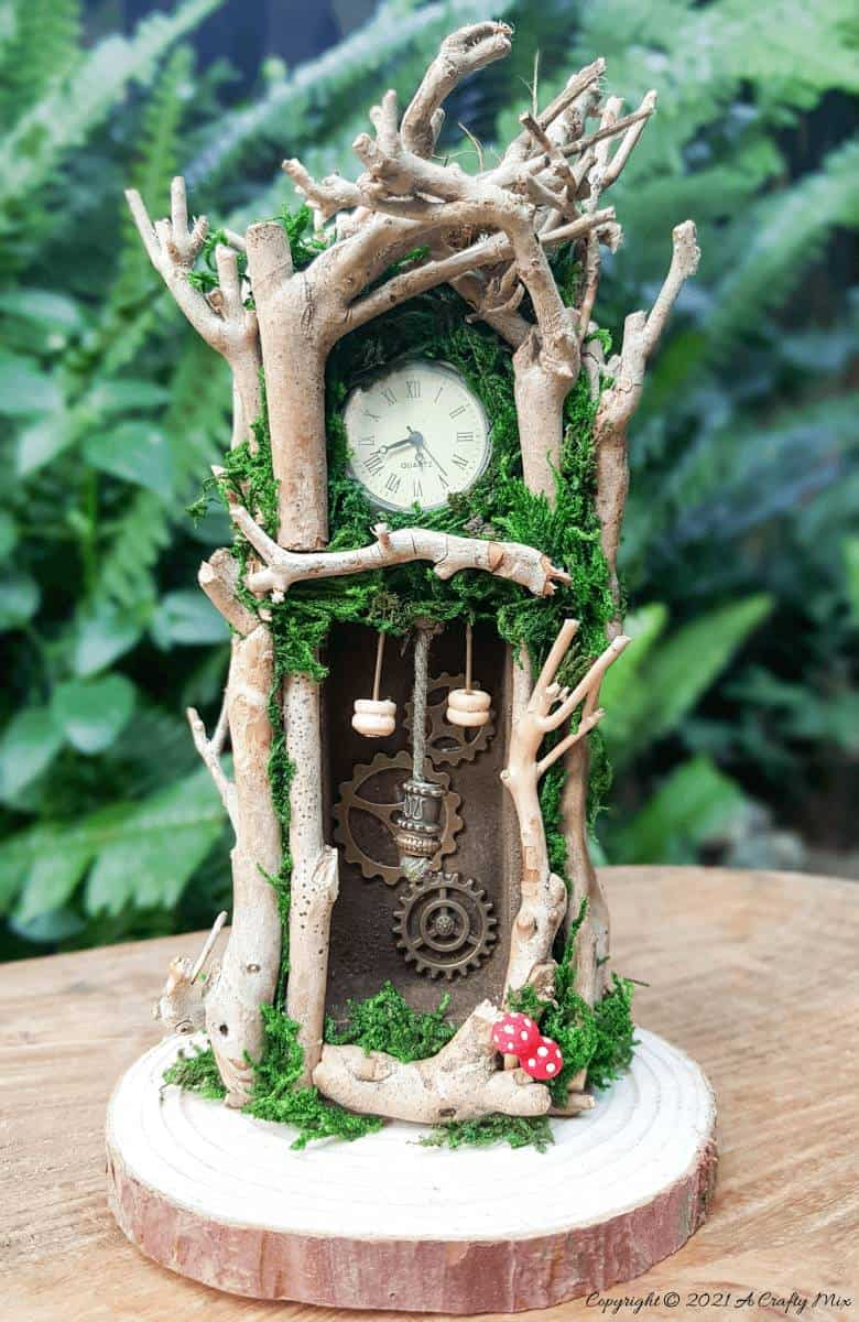 Have you ever wanted to make a real working fairy grandfather clock? This tutorial will show you how and includes a downloadable template along with instructions to make teeny, tiny mushrooms and a fairy bird's nest. #FairyCrafts #ACraftyMix #MiniatureGrandfatherClock