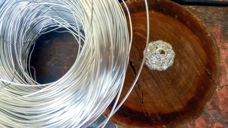 To make the art deco wire birdcage you'll need wire, some sort of base and a large crystal bead