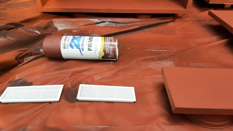 Hand sand the melamine lightly with 120 grit sandpaper before painting