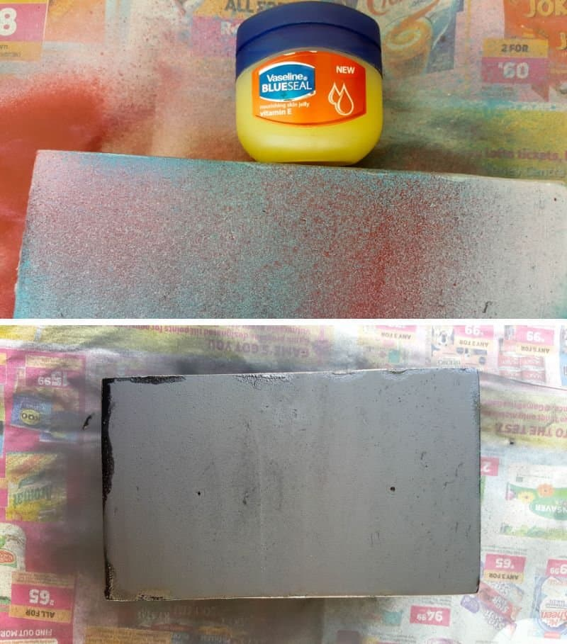 Rub a little petroleum jelly along the edges of the platform and spray black.